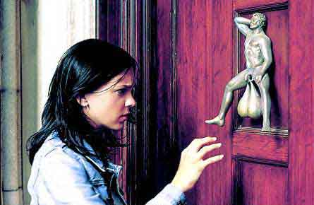 Girl contemplating knocking on a door, for which the knocker is the testicles of a little man's statue